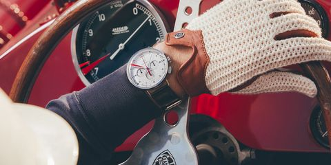 Watch, Red, Wrist, Gauge, Material property, Strap, Hand, Fashion accessory, Tachometer, Analog watch,