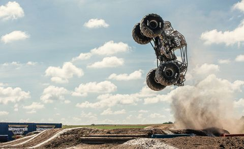 Automotive tire, Cloud, Sky, Tire, Soil, Flip (acrobatic), Stunt performer, Jumping, Vehicle, Auto part,
