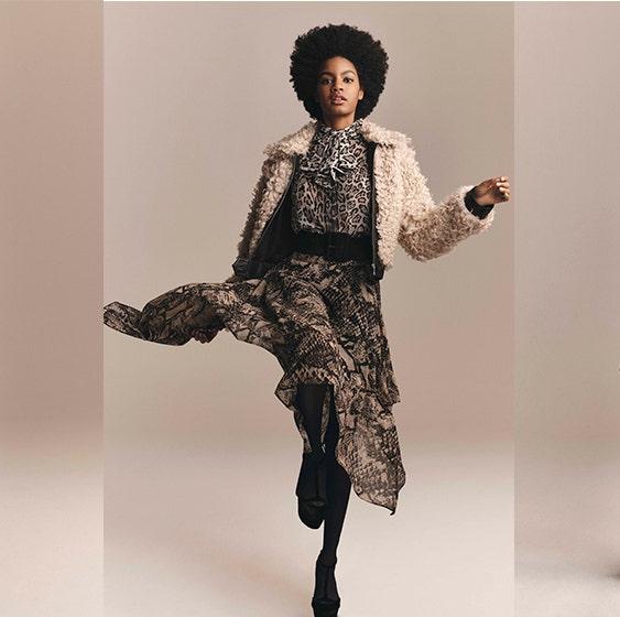 Clothing, Fashion, Fashion model, Fashion design, Outerwear, Costume design, Neck, Victorian fashion, Waist, Headgear,