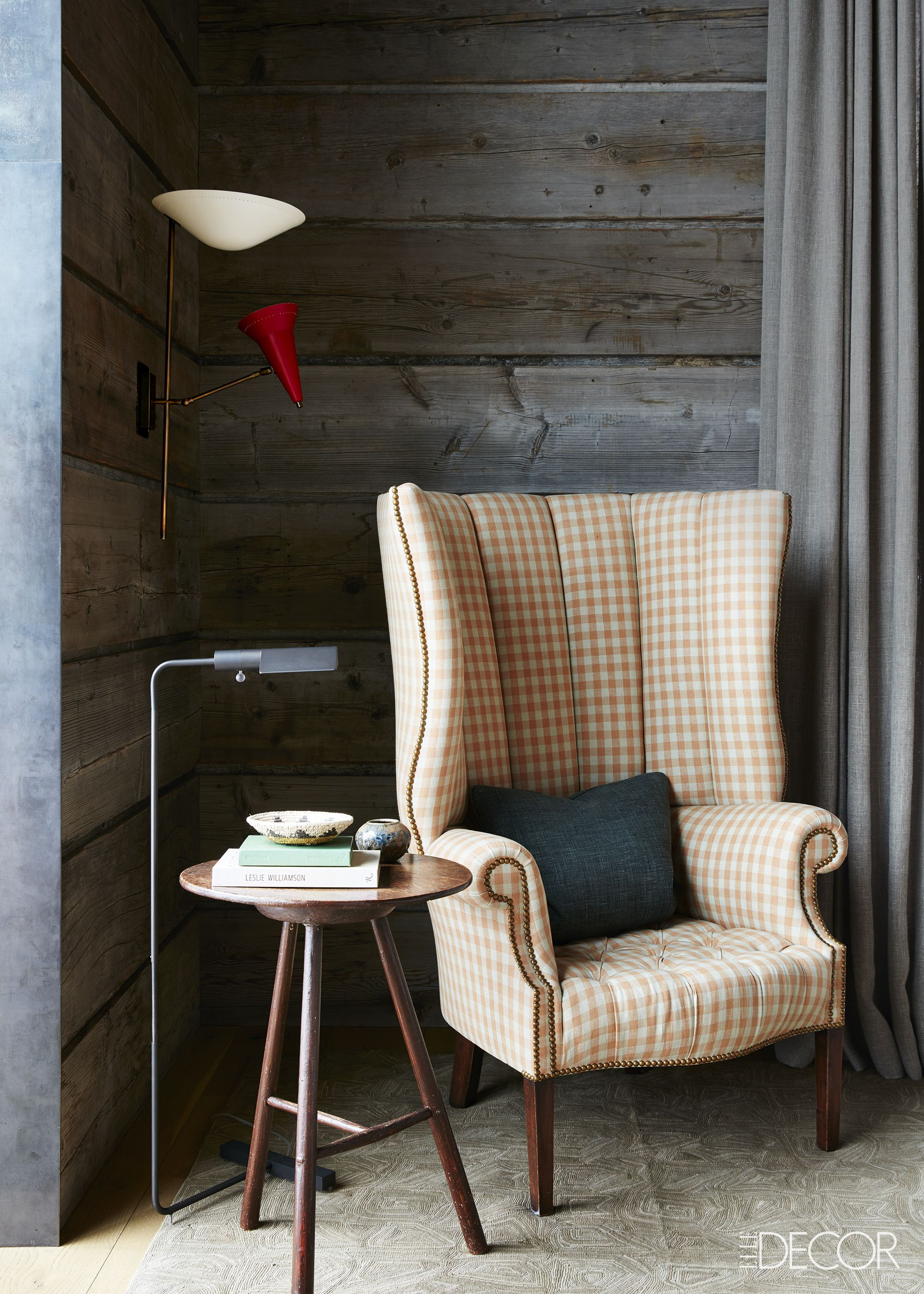 Rustic wide plank wood walls in cozy seating area with wingback chair on Hello Lovely