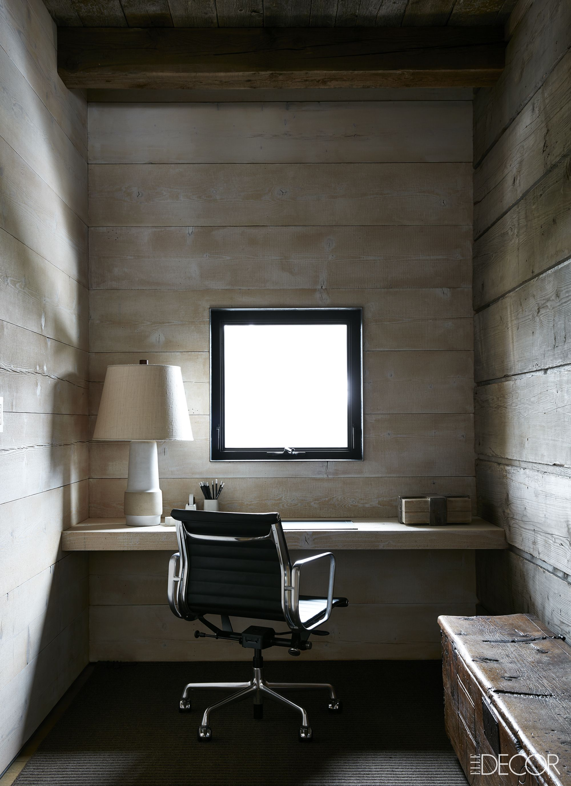 Reclaimed wood walls in rustic luxe office with Midcentury modern furniture on Hello Lovly