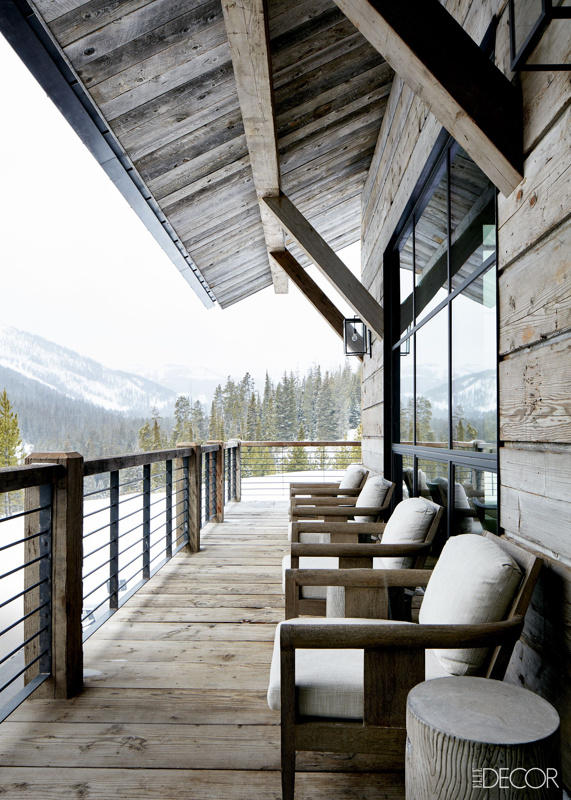 Rustic deck on ski chalet home in mountains on Hello Lovely