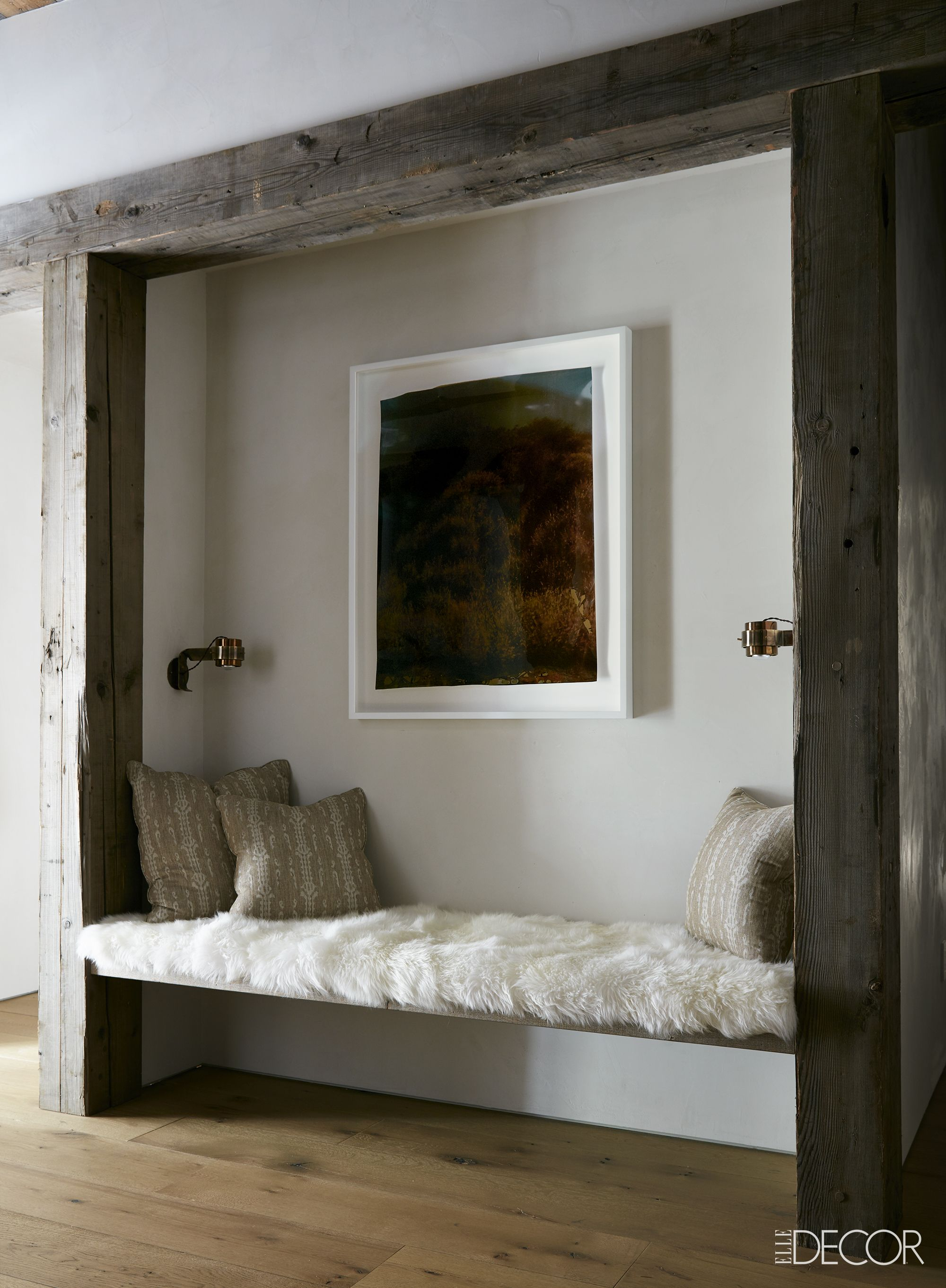 Built-in bench in rustic chic home library with shearling upholstery on Hello Lovely