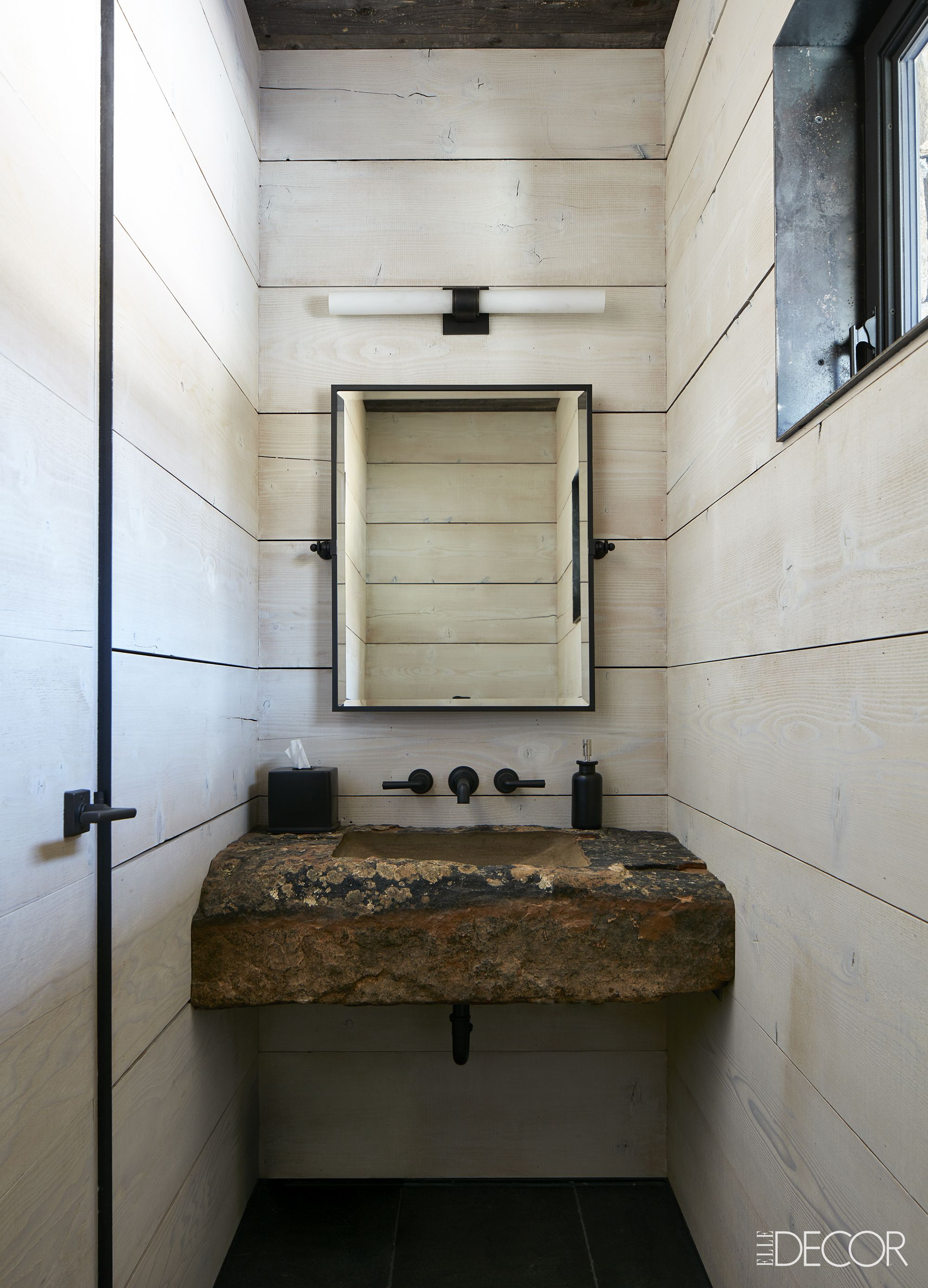 Rustic powder room with stone sink, whitewashed reclaimed wood walls, and Waterworks fixtures on Hello Lovely
