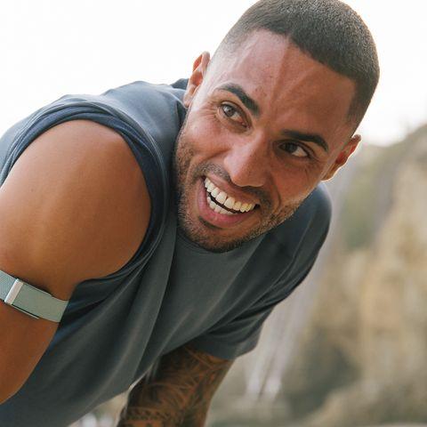 man wearing whoop band during run