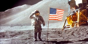 Astronaut David Scott Salutes by U.S. Flag