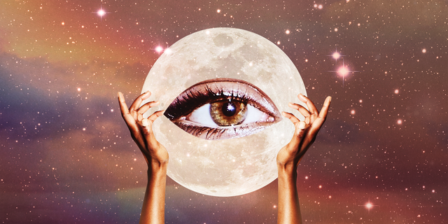 two hands hold up a giant eye over a moon
