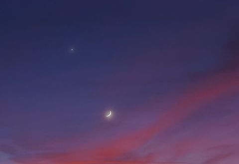 moon and mars against orange pink clouds