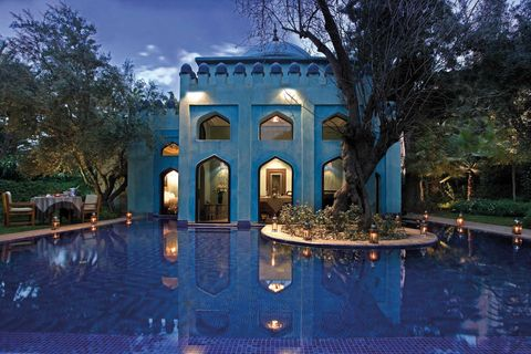 Blue, Property, Building, Lighting, Architecture, Sky, Water, Majorelle blue, Estate, Swimming pool,