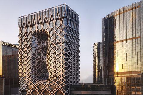 Architecture, Tower block, Iron, Urban design, Skyscraper, Commercial building, Composite material, Metal, Engineering, Symmetry,