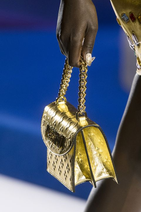 Hand, Brass, Bell, Metal, Fashion accessory,