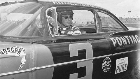 glenn roberts sitting in race car
