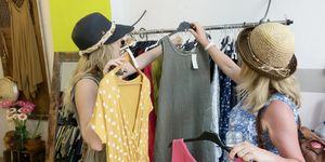Mother and daughter shopping in clothes shop