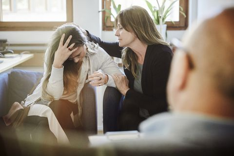 mother consoles daughter during therapy session at workshop