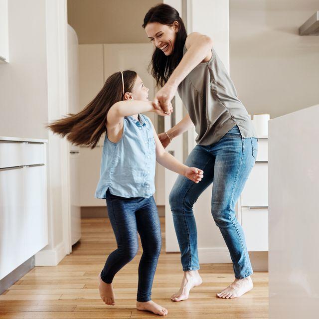 mother daughter dancing in kitchen