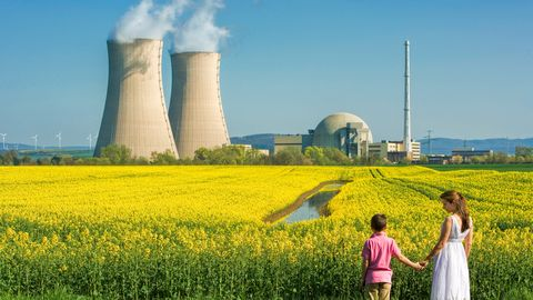 Mother Holding Hands with Son at Nuclear Power Station