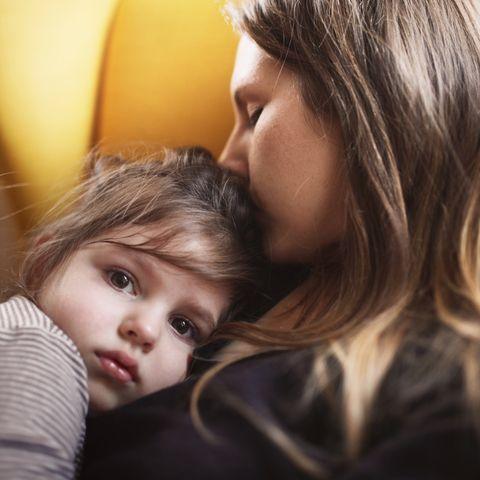 mother hugs sad daughter