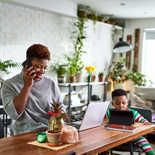 jobs for stay at home moms - Mother looking after son and working from home
