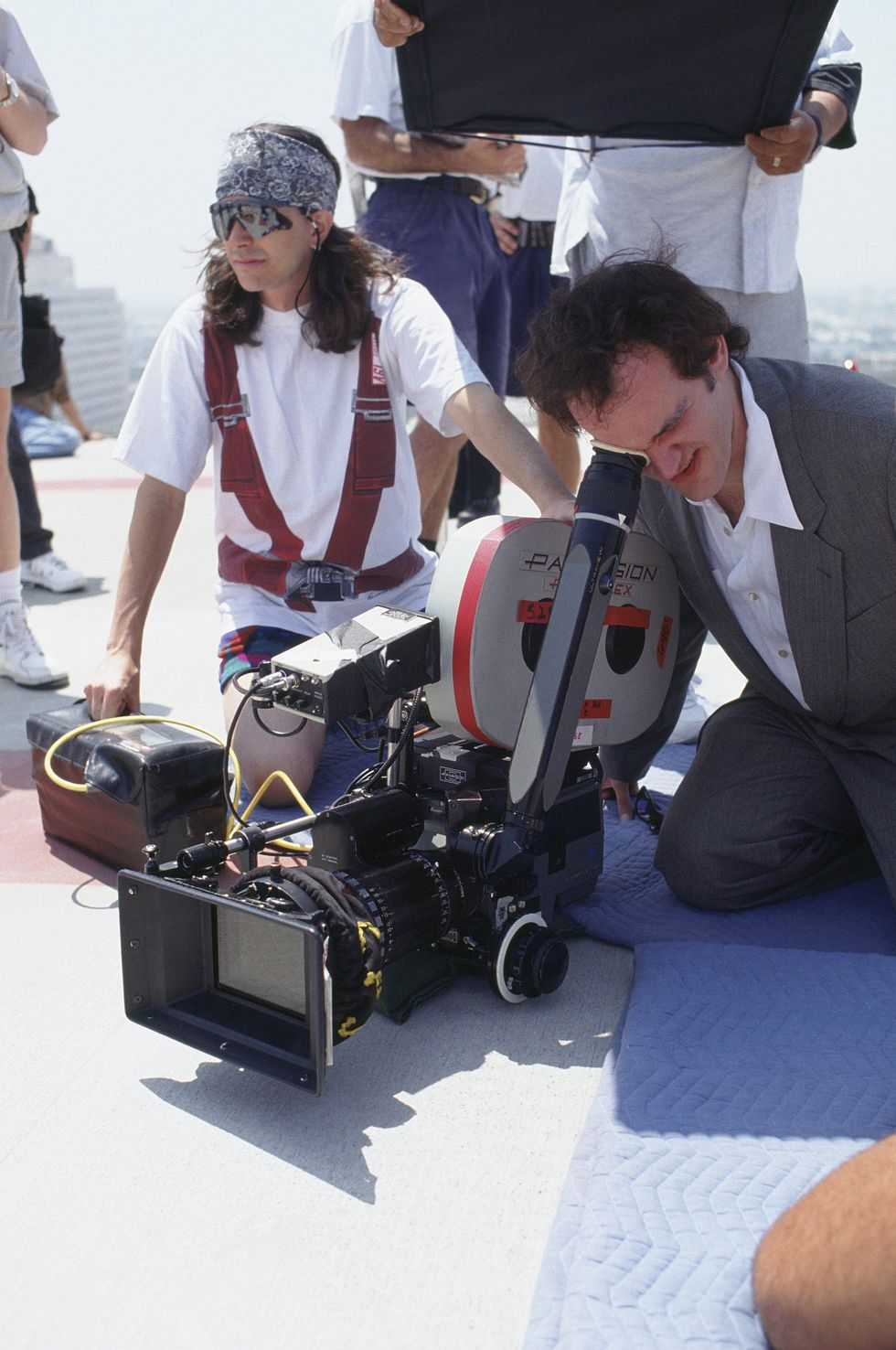 ER (1995) Tarantino takes a look at a shot while filming ER. The director received $30,000 for the gig , and the episode aired on May 11, 1995.