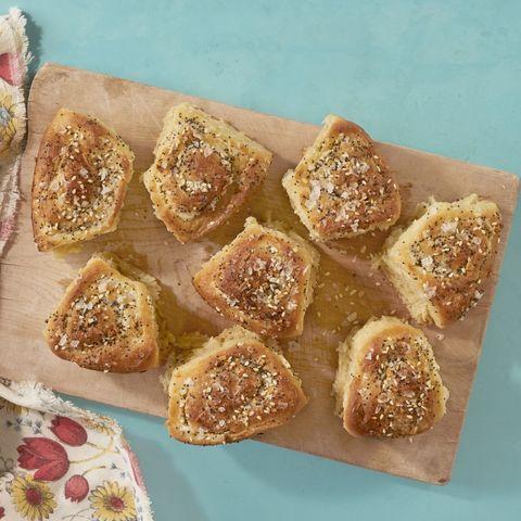 eveerything bagel buns on wood board