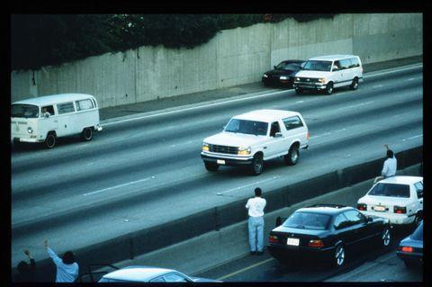 motorists wave at oj simpson during police freeway pursuit