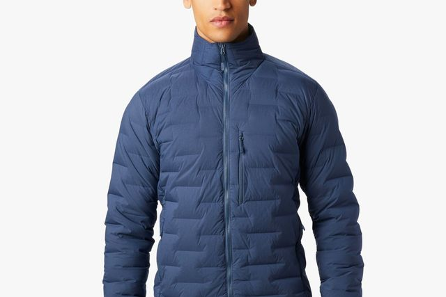 a man wearing a blue down jacket