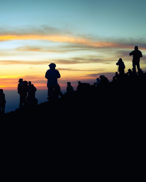 Mountaineers and Sunrise on the summit of Mount Fuji in Japan