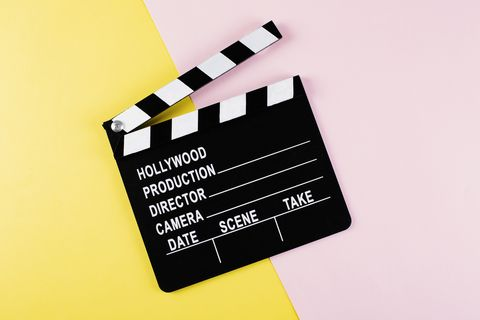 movie clapper board on yellow and pink background with copy space