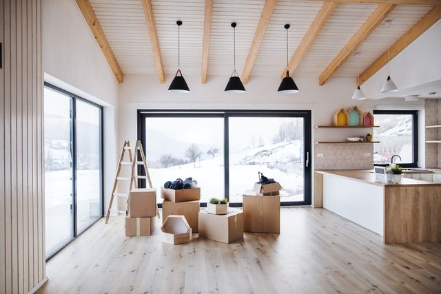 moving boxes in modern living room in a new home