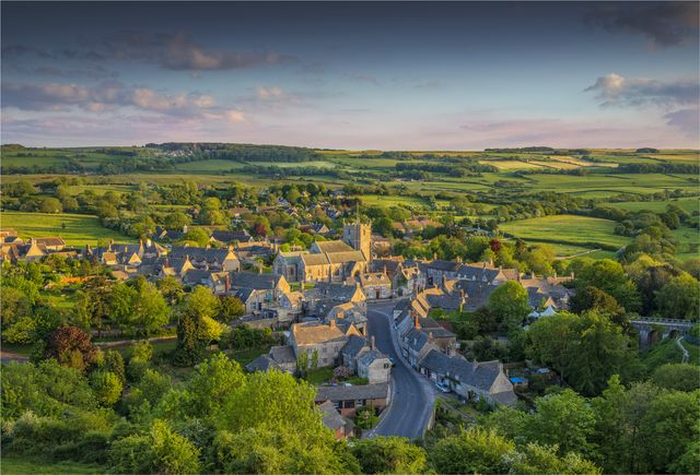 an overview of the beautiful small village of corfe on the isle of purbeck in warm evening light dorset england