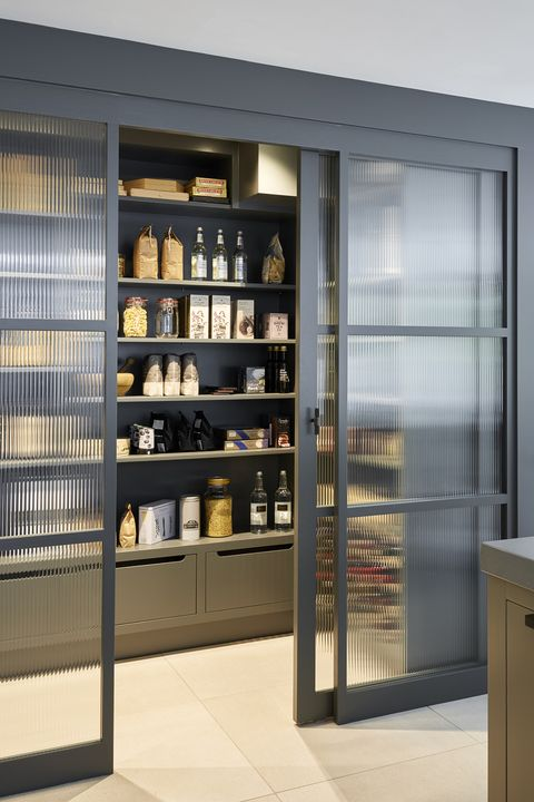 Kitchen larder behind glass doors