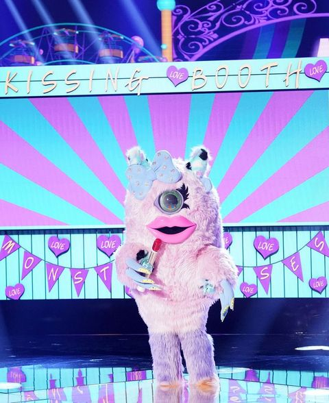 Performance, Pink, Stage, Event, Fictional character, Performing arts, Performance art, Display device,