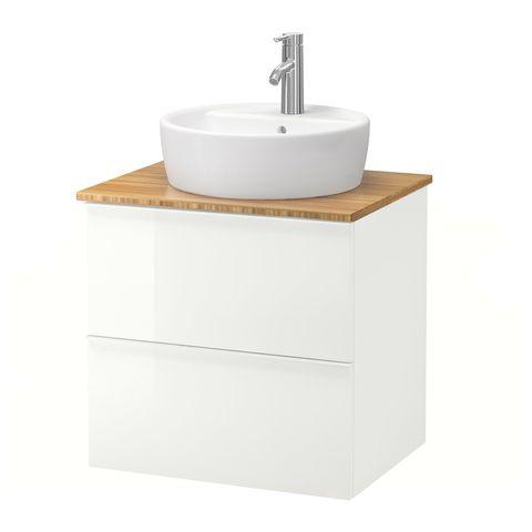 mueble de lavabo con dos cajones blancos sin tiradores y encimera de bambú