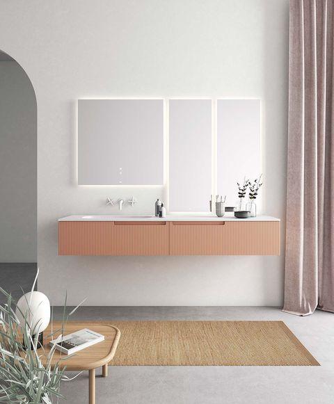 un mueble de baño color rosa