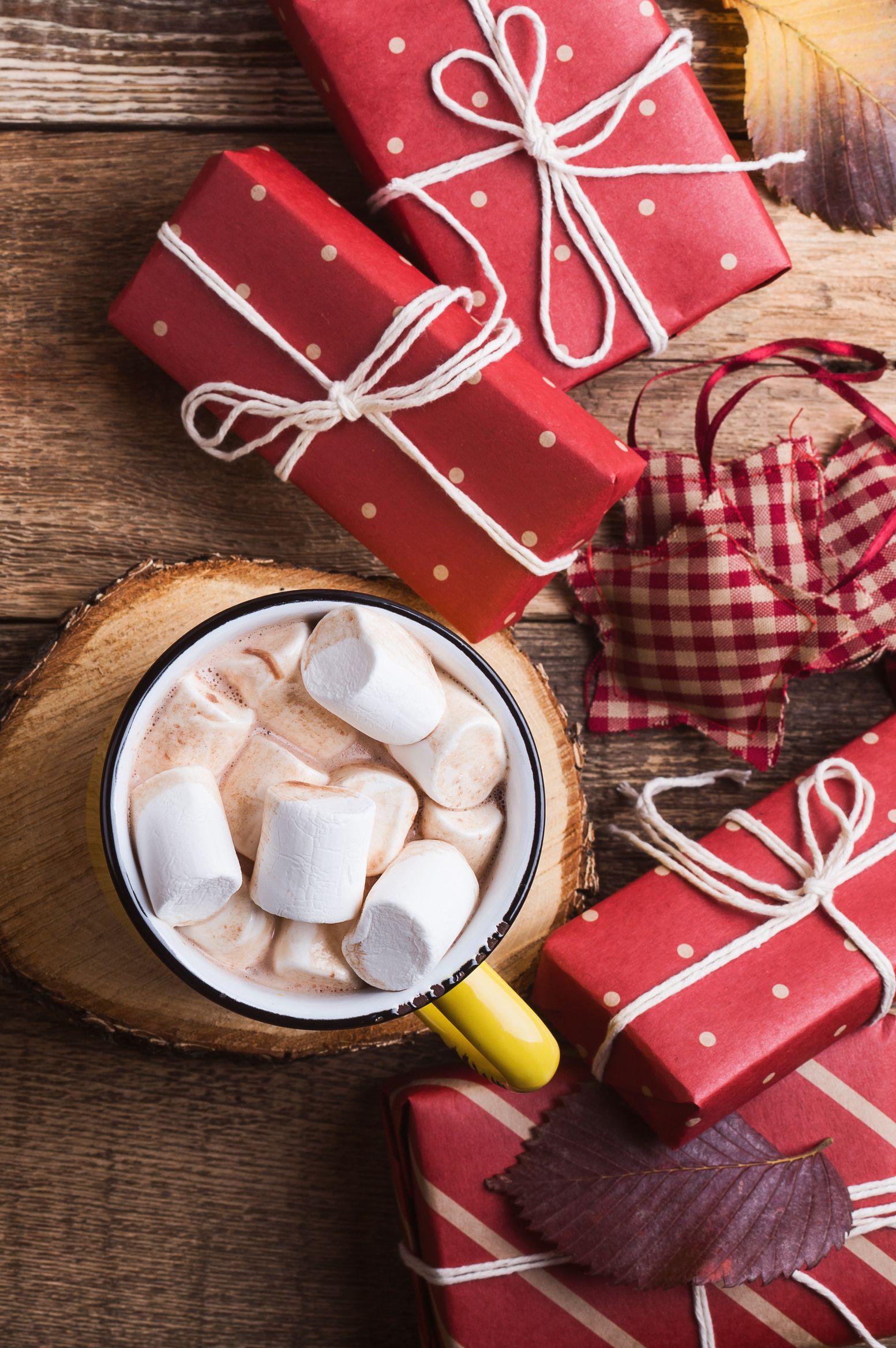 Christmas bible verses Mug of hot chocolate and Christmas gift boxes