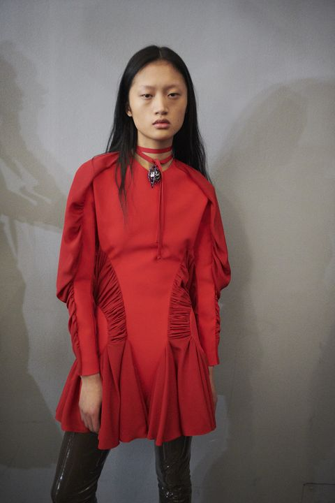 Clothing, Red, Outerwear, Fashion, Orange, Coat, Fashion design, Sleeve, Overcoat, Neck,