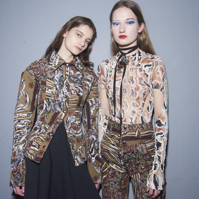 Fashion model, Clothing, Fashion, Fashion design, Outerwear, Fashion show, Visual arts, Runway, Street fashion, Pattern,