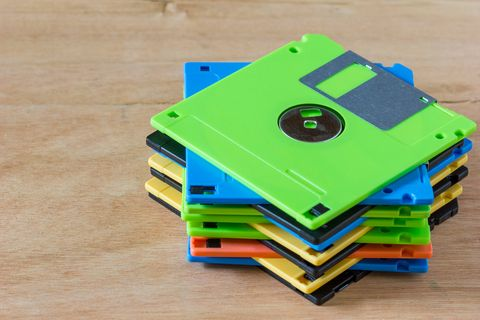 Multi Colored Stacked Floppy Disks On Table