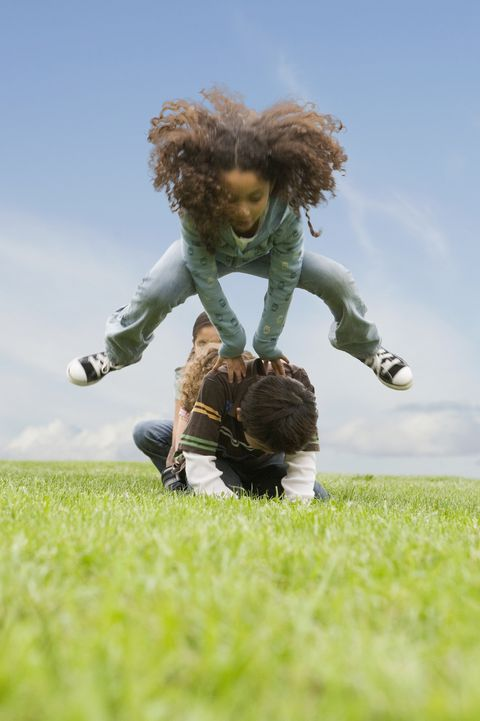 leap day activities - Multi-ethnic children player leap frog in field