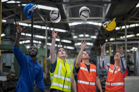 multi ethnic of factory workers working success production or business achieve target