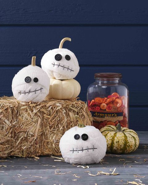 mummy pumpkins small white pumpkins covered in gauze with button eyes and staple mouths