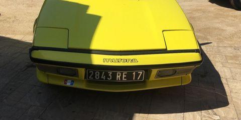 Land vehicle, Vehicle, Car, Yellow, Coupé, Hood, Bumper, Sports car, Automotive exterior, Alpine a310,