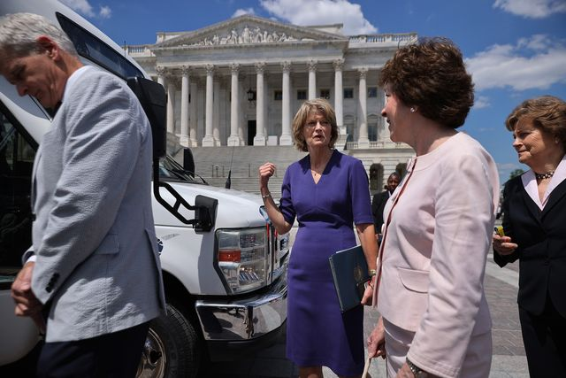 washington, dc   june 24 l r sen bill cassidy r la, sen lisa murkowski r ak, sen susan collins r me, sen jeanne shaheen d nh and other senators board a bus before leaving the us capitol for a meeting at the white house on june 24, 2021 in washington, dc following the meeting at the white house, president joe biden announced that he and the bipartisan senators had struck a deal on a nearly $1 trillion infrastructure deal with new investments in roads, broadband internet, electric utilities and other projects photo by chip somodevillagetty images