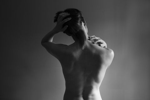 Muscular back of nude Caucasian woman