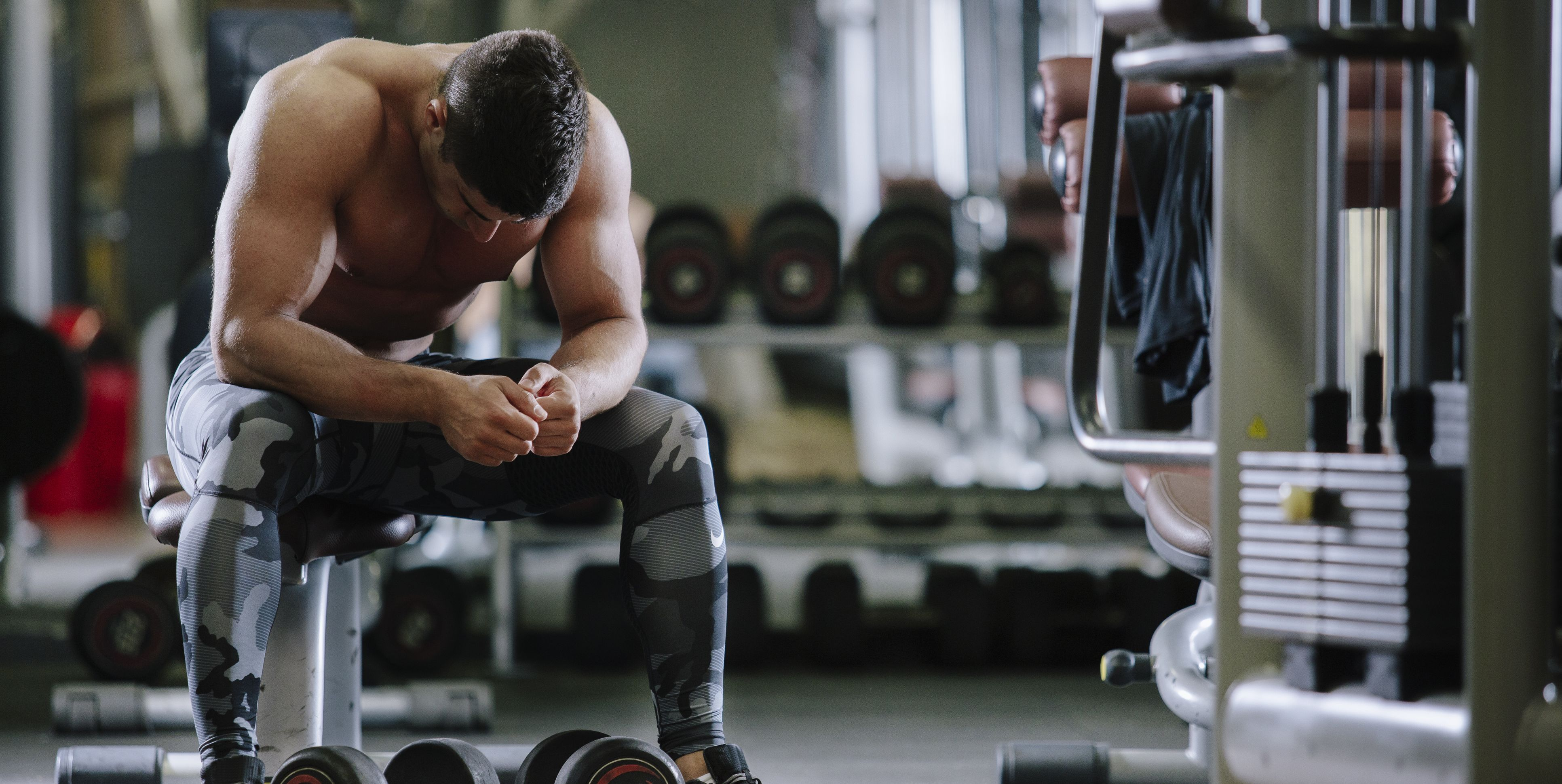 Muscular Fit Man Exercising in a Gym