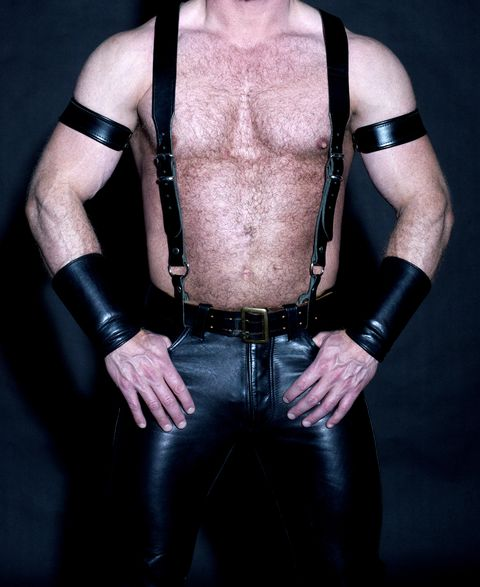 muscular male torso dressed in fetish leather