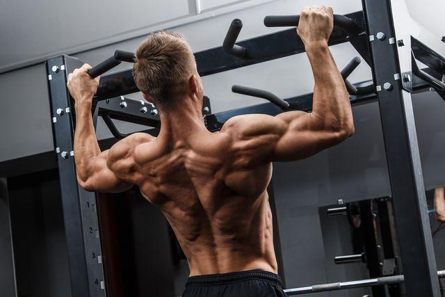 muscular man training his back