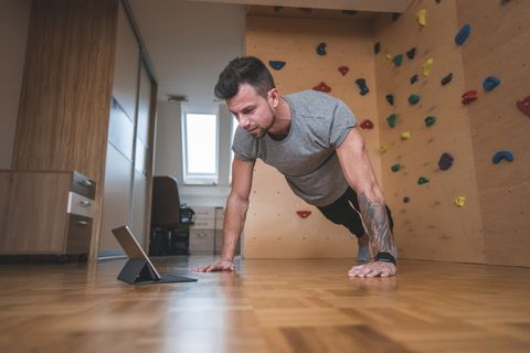 Muscular man working out at home gym
