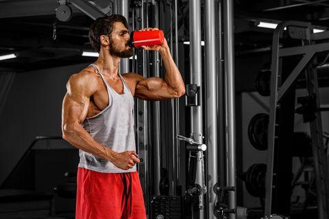 Muscular Men Drink His Nutritional Supplement