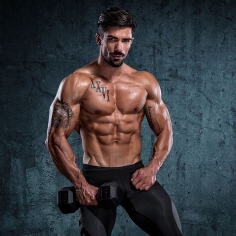 Handsome Fitness Man With Muscular Body Outdoors In Summer